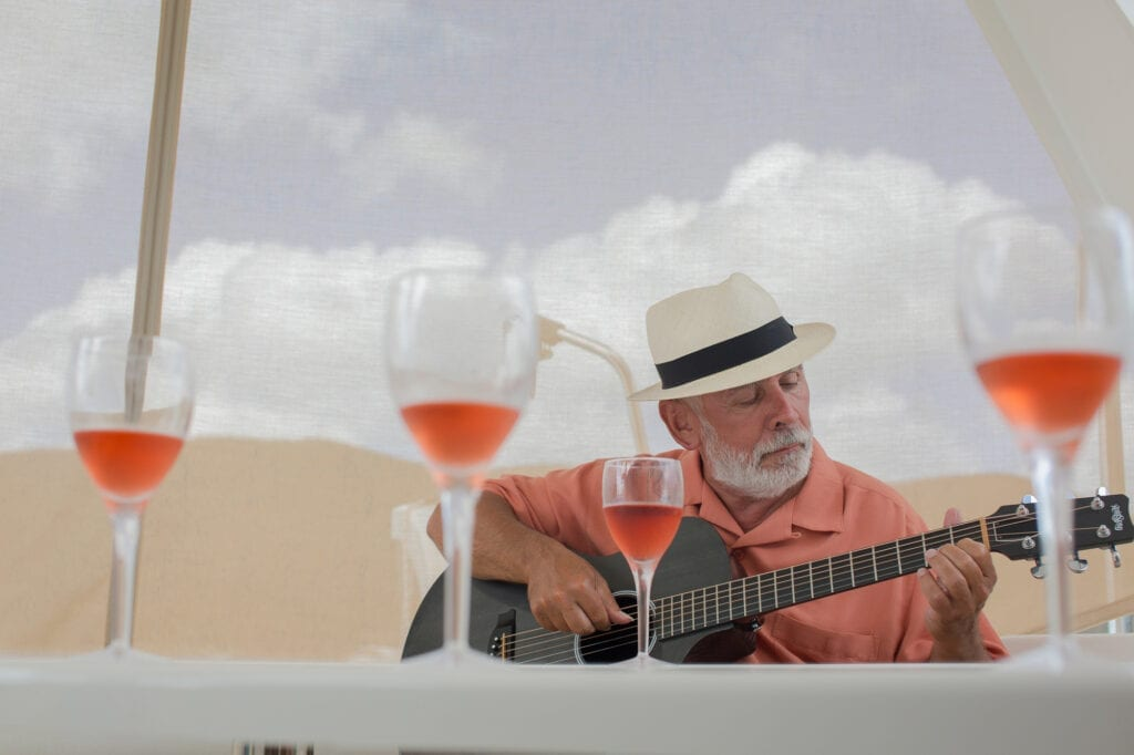 Man playing guitar on boat OBX