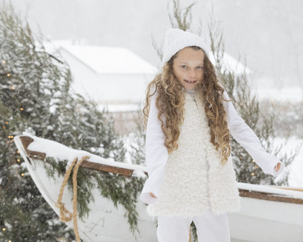 Little girl in the snow Christmas time