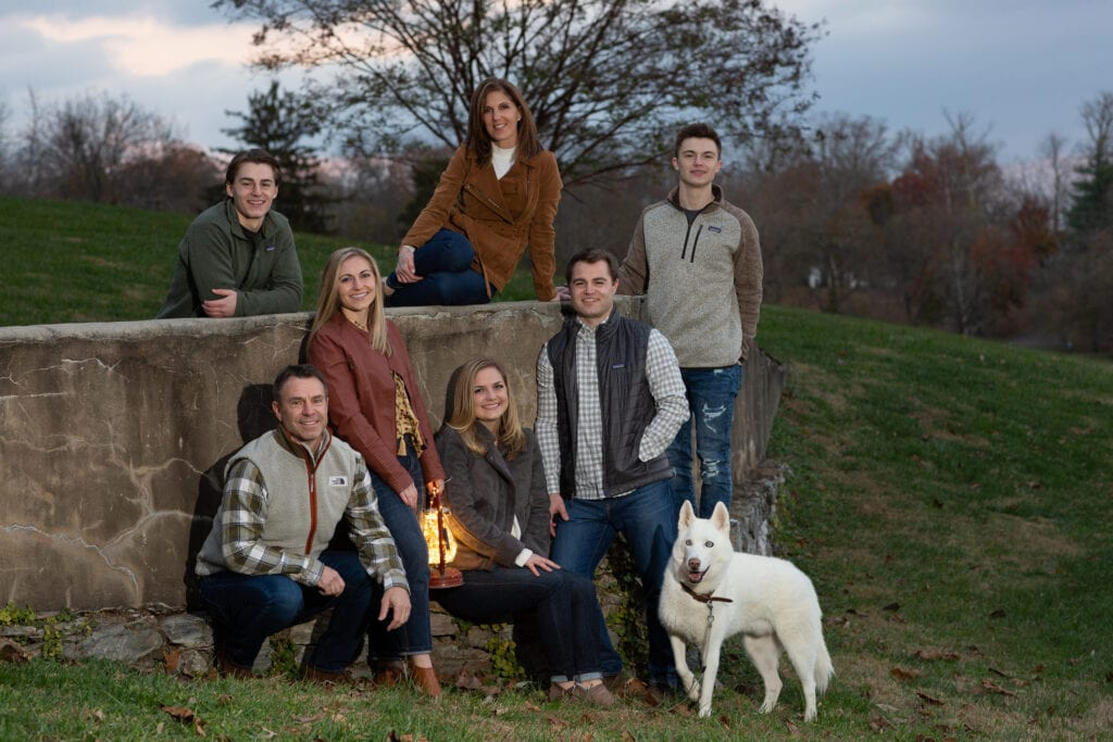 Family at Morven Park at dusk in fall colors