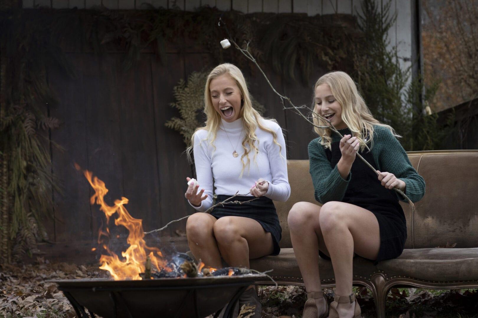 sisters by fireside roasting marshmallows in Leesburg Virginia