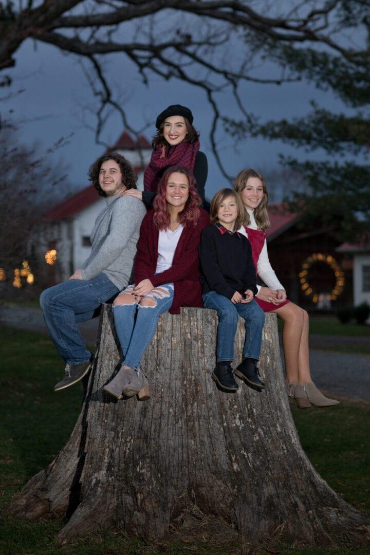 Family at dusk on 100 year old Oak tree