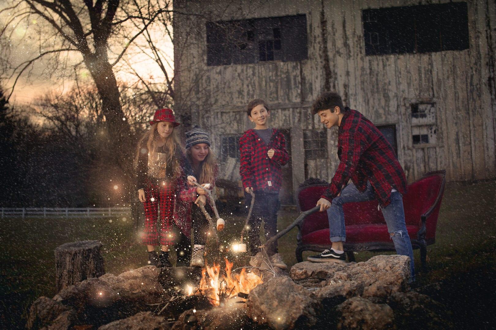 four children around a festive camp fire