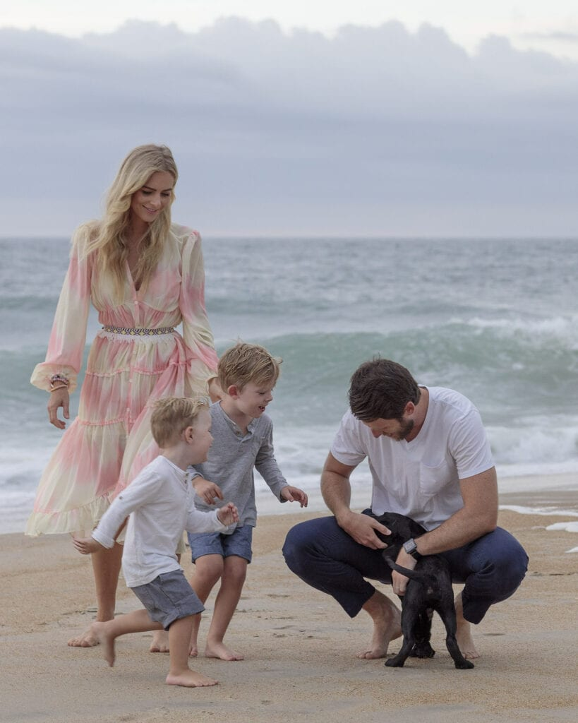 Family on beach with puppy