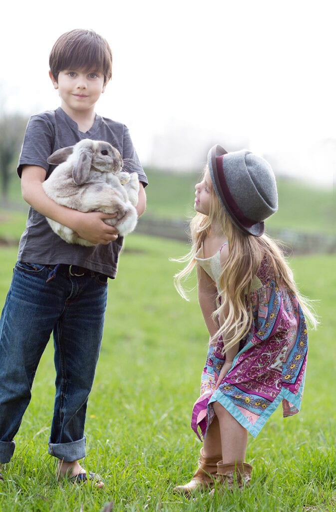 spring pictures of girl and boy with bunny