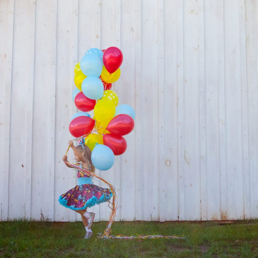 bouquet of balloons with birthday girl
