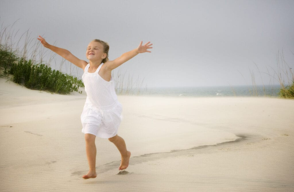 Girl running on beach with love in her expression