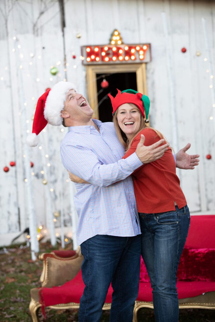 Older couple enjoying the spirit of Christmas by a festive old barn in Loudoun County