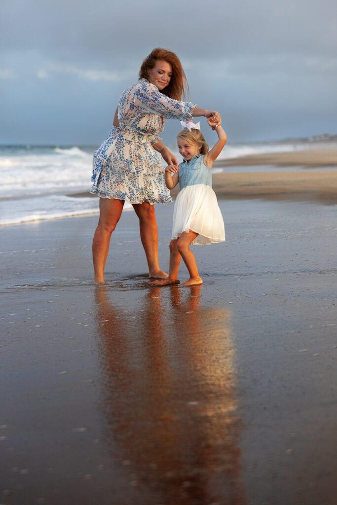 Mom ad daughter on beach