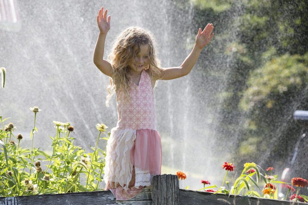 Little girl with flowers in garden Loudoun County farm
