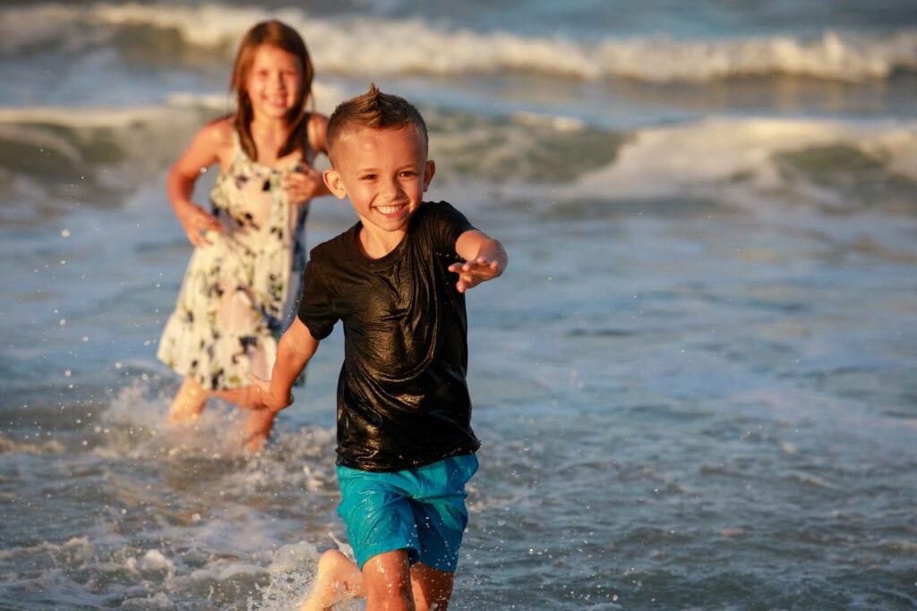 Boy running in the waves, Corolla NC