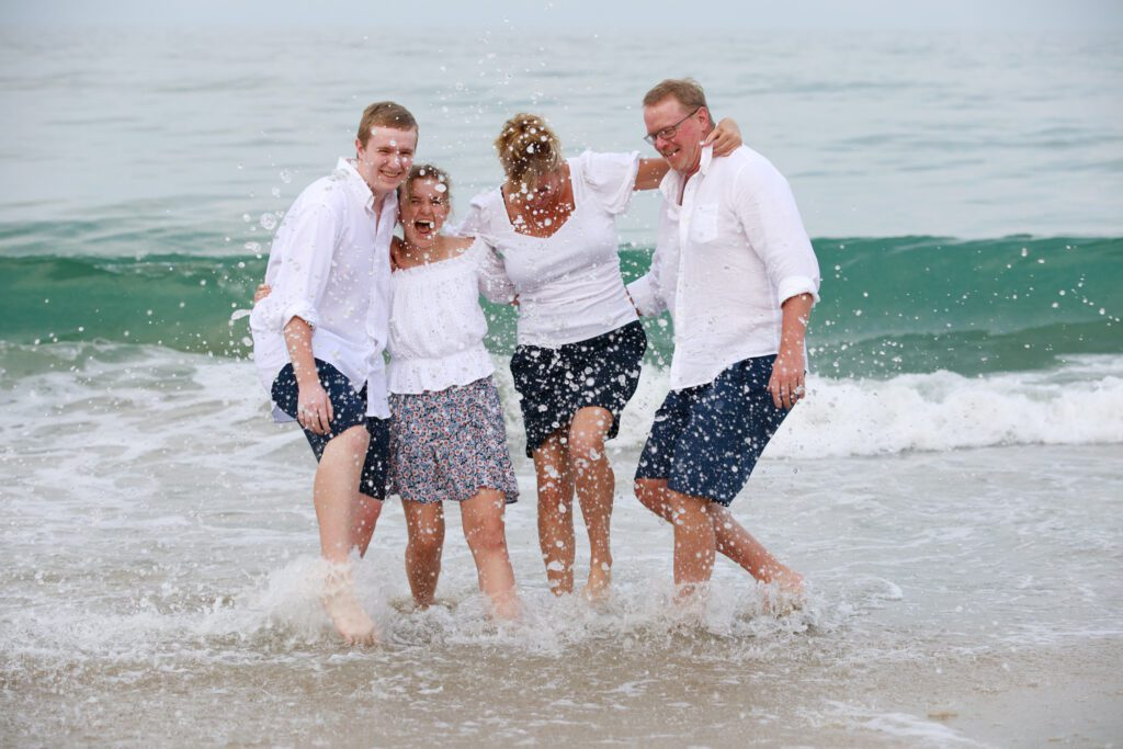 family splashing in the waves Duck, NC