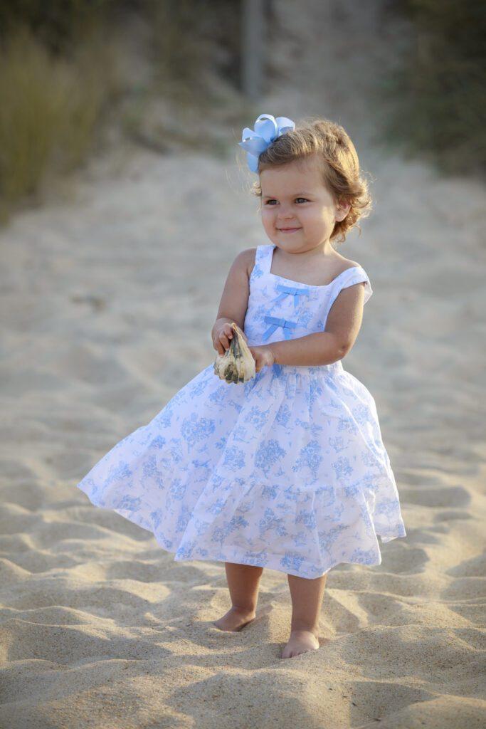 little girl in beautiful dress with seashell duck nc