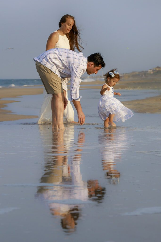 you family on the beach with beautiful reflection duck nc