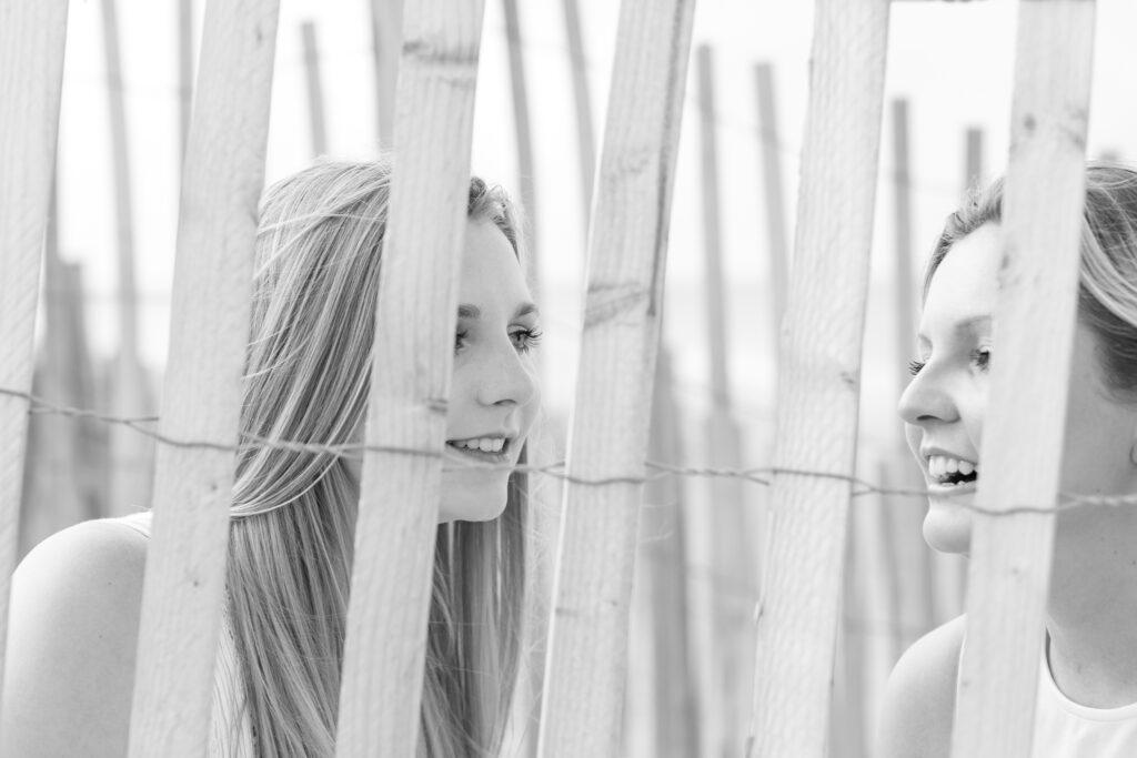 girls behind sand fence nags head nc