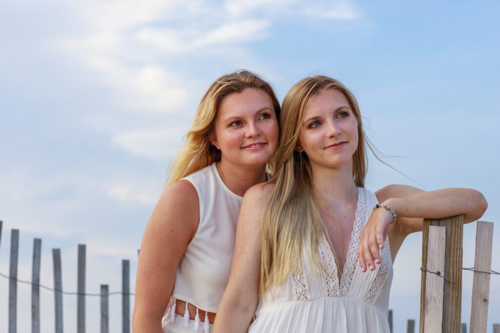 beautiful sisters by sand fence outer banks nc