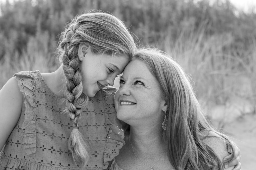 loving mother and daughter near the dunes in duck nc