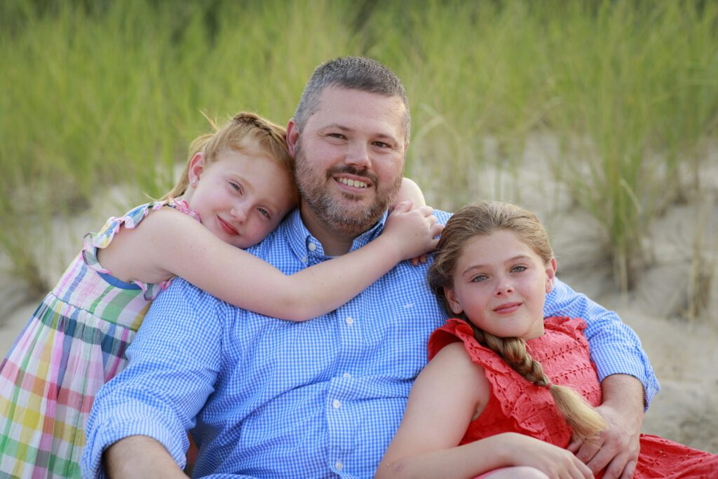 dad and his girls by the dunes in Duck NC