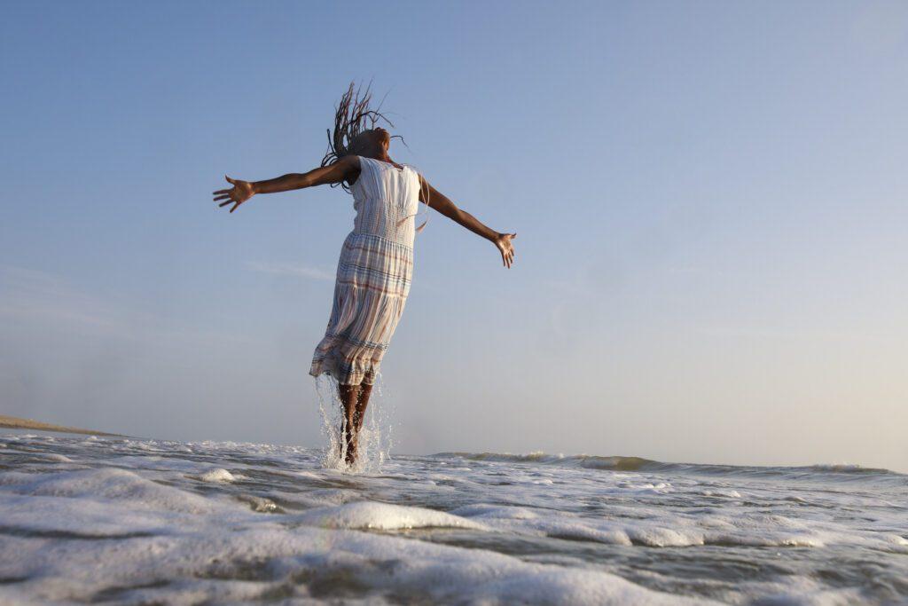 Dancer jumping in the ocean waves Pea Island, NC