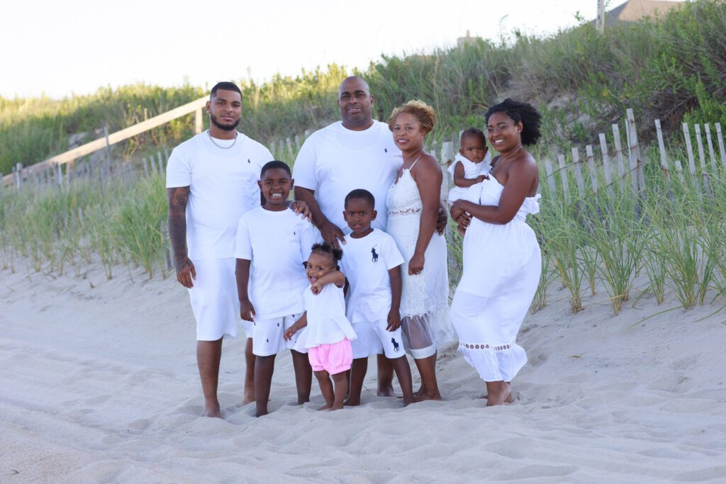 Family looking great in all white clothes on the beach in Duck NC