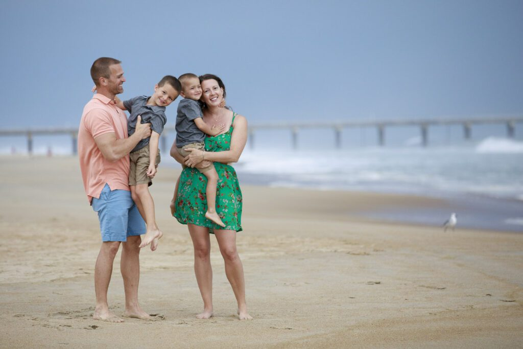 Family on the beach in the beautiful stormy light