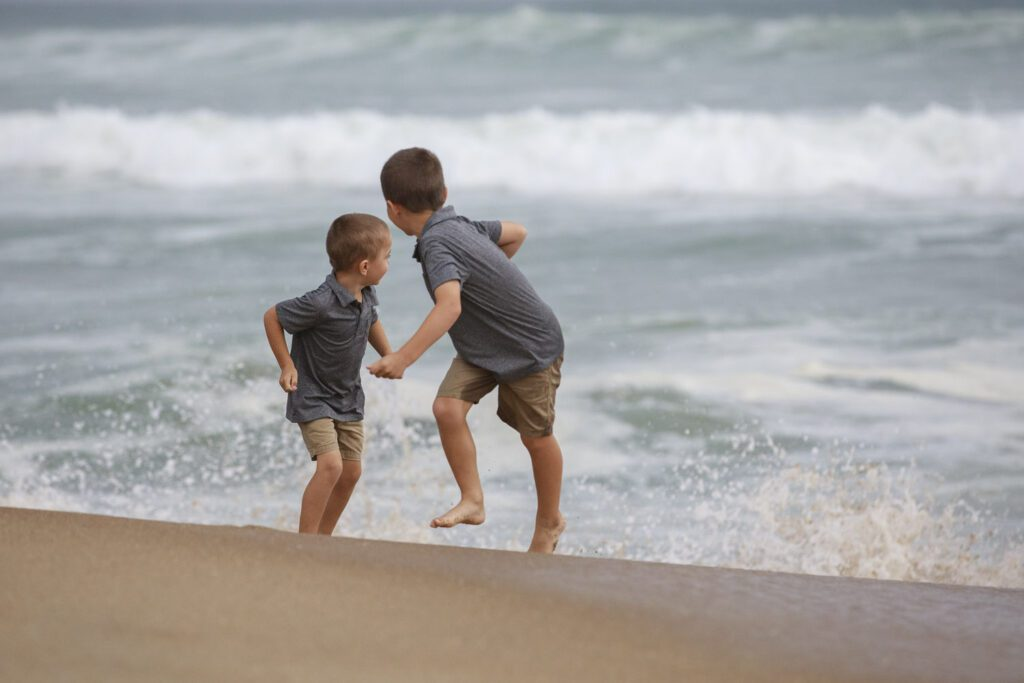 boys running from the waves, Duck, NC