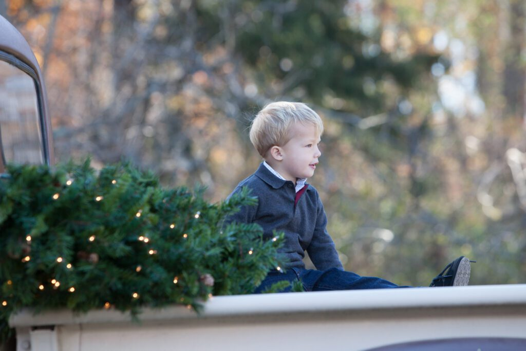 Little boy on vintage truck with Christmas tree Loudoun County