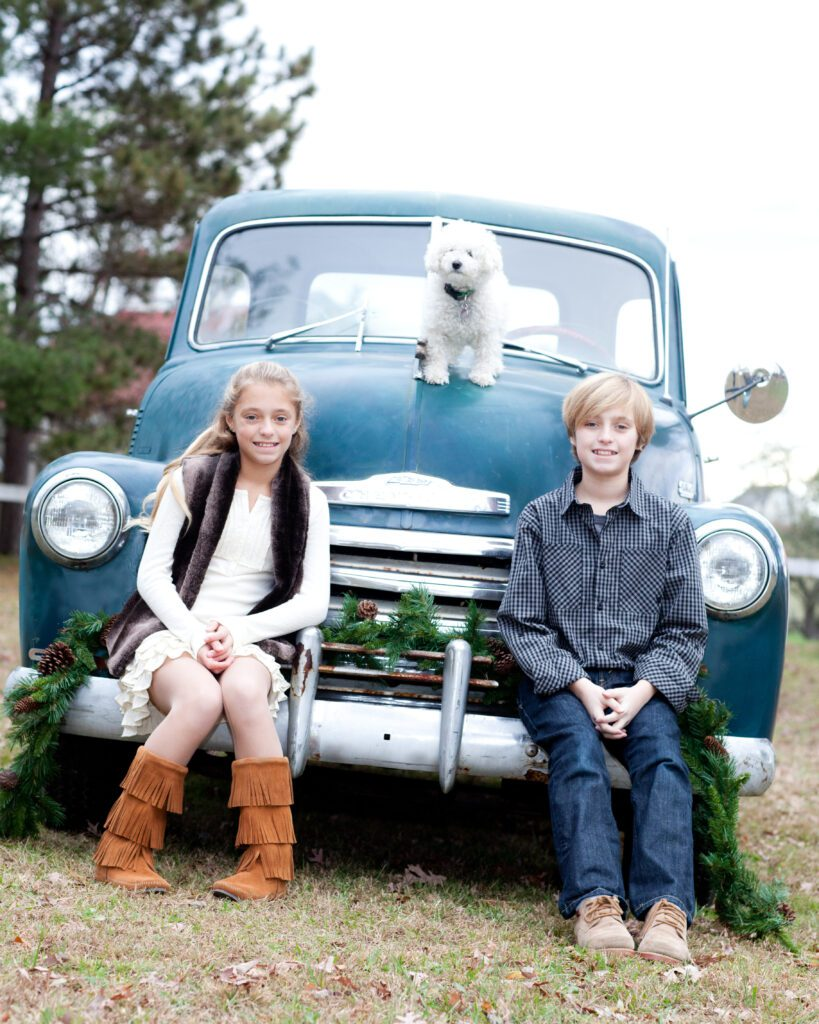Vintage truck with kids and their dog